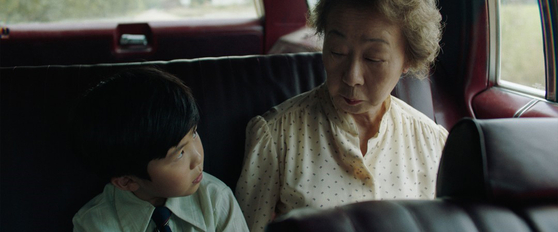"Youn, right, and her grandson David (played by Alan Kim) from the film ""Minari."" [PAN CINEMA]"