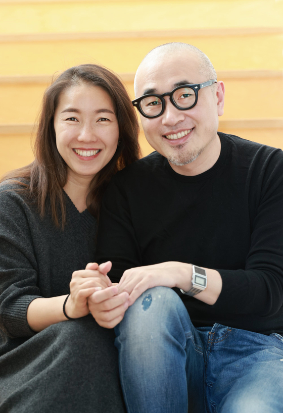 Kim Bong-jin, right, founder and CEO of Woowa Brothers and his wife Sul Bo-mi. [WOOWA BROTHERS]