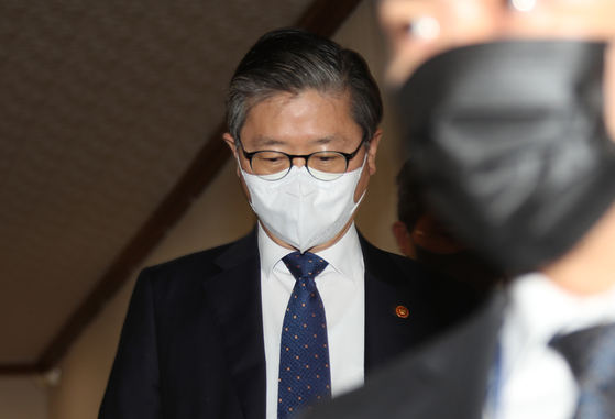 Land Minister Byeon Chang-heum attends a government meeting on the real estate crisis at the government complex in Seoul on Friday. [YONHAP]