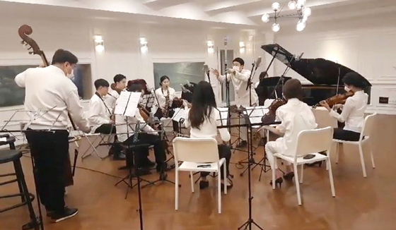 "The Lindenbaum Festival Orchestra makes the first recording of ""Protein Antibody"" on March 7 at a studio in Seoul. [LINDENBAUM]"