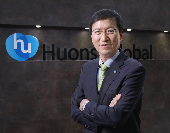 Huons Global Vice Chair and CEO Yoon Sung-tae poses in front of the company's logo after an interview with the Korea JoongAng Daily in Bundang, Gyeonggi, on March 3. [PARK SANG-MOON]