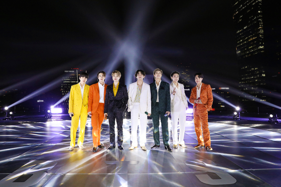 "BTS became the first-ever K-pop act to perform solo at the Grammys Award on Monday, Korean time. The band recorded a video of their performance for the 2020 hit ″Dynamite″ from Seoul which was played during the awards ceremony. BTS was nominated for the Best Pop Duo/Group Performance award for ""Dynamite,"" but did not win [BIG HIT ENTERTAINMENT]"