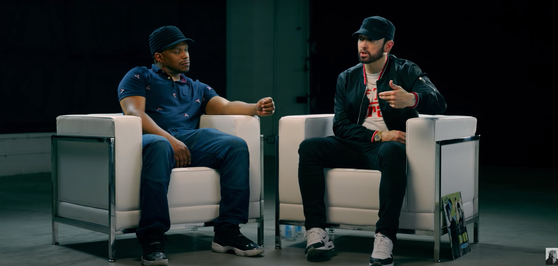 Rapper Eminem, right, calls out the Grammy Awards during an interview in 2018. [SCREEN CAPTURE]