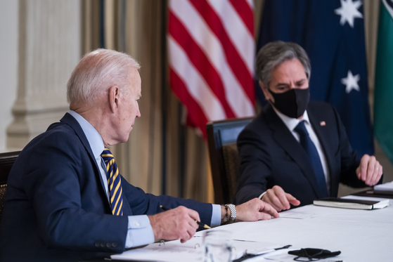 U.S. President Joe Biden, left, and Secretary of State Antony Blinken take part in a virtual summit with Quad leaders from India, Australia and Japan at the White House in Washington Friday. Blinken and U.S. Defense Secretary Lloyd Austin kick off their trips to Tokyo and Seoul this week. [EPA/YONHAP]