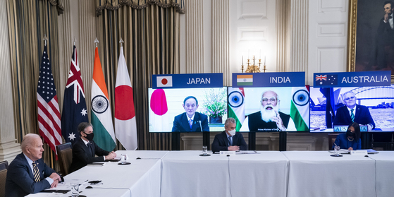 U.S. President Joe Biden holds his first virtual Quad summit with leader of Japan, Australia and India on March 12. [UPI/YONHAP]