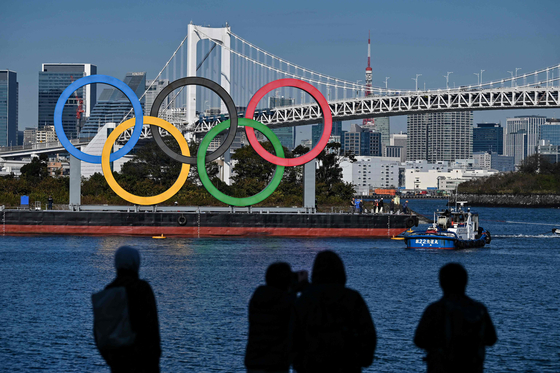 Overseas fans will be banned from this summer's pandemic-delayed Tokyo Olympics, organizers said on Saturday, in a bid to reduce the risk of spreading the virus and ease the Japanese public's anxieties. [AFP/YONHAP]