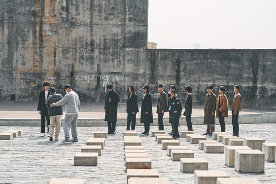 Designer Yoo Hyun-chul's DWS Company films the collection at the Oil Tank Culture Park in Sangam-dong, western Seoul on March 9. [SEOUL METROPOLITAN GOVERNMENT]