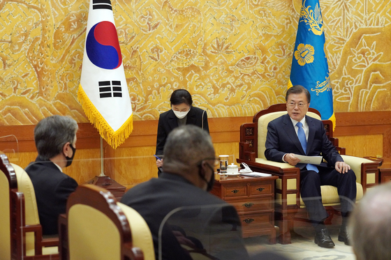 "President Moon Jae-in, right, tells U.S. Defense Secretary Lloyd Austin and U.S. Secretary of State Antony Blinken at the Blue House in central Seoul Thursday that South Korea and the United States share ""core values and basic ideals such as democracy and human rights."" [JOINT PRESS CORPS]"