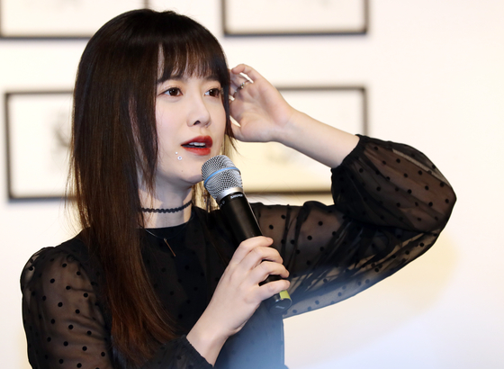 Actor Koo Hye-sun explains the details of her solo exhibition ″Koo Hye Sun's Newage under Seo Taiji's Lyrics″ (translated) on the day of the exhibition's opening on Tuesday at the Hangaram Museum in Seoul Arts Center, southern Seoul. [ILGAN SPORTS]
