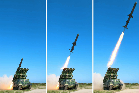 Pyongyang fires new cruise missiles from a test site in Wonsan in Kangwon Province under the supervision of North Korean leader Kim Jong-un on June 8, 2017, in a photo revealed by the North's official Rodong Sinmun. North Korea launched multiple short-range Kumsong-3 cruise missiles from Munchon in its eastern Kangwon Province, into the East Sea on April 14, 2020. The North fired two cruise missiles off its west coast Sunday. [YONHAP]