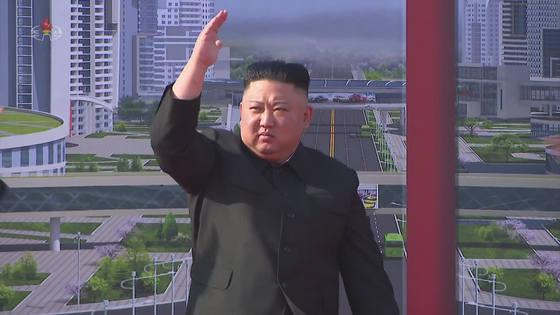 North Korean leader Kim Jong-un waves his hand during a ceremony to break ground for building 10,000 homes in Pyongyang in an image captured from state television. [YONHAP]
