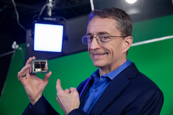 """Intel CEO Pat Gelsinger holds Intel's first exascale graphics processing unit during the recording of the """"Intel Unleashed: Engineering the Future"""" webcast on March 23. [INTEL]"""