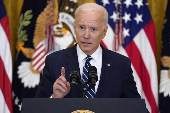 "U.S. President Joe Biden warns that the United States will ""respond accordingly"" if North Korea chooses to escalate tensions in his first press conference since taking office in the East Room of the White House in Washington Thursday. [AP/YONHAP]"