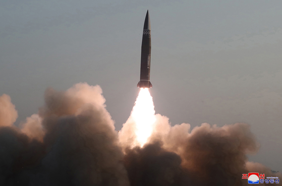 North Korea launches short-range ballistic missiles from Hamju County in South Hamkyong Province into the East Sea Thursday morning, as pictured in a photo released by the North's official Korean Central News Agency (KCNA) Friday. The KCNA said that North Korea successfully tested new tactical guided missiles. [YONHAP]