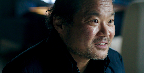 Sung-ha (played by Kim Sang-ho) is a photographer who believes that a miracle could save his wife from death. [ATNINE FILM]