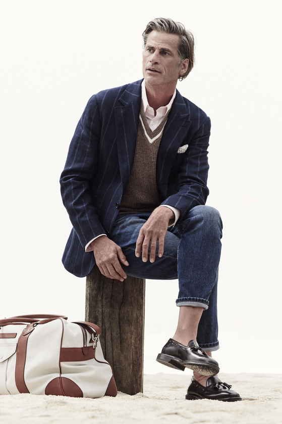 Blue jeans paired with a striped suit jacket. [BRUNELLO CUCINELLI]