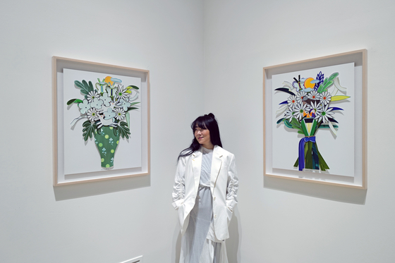 Artist Nanan Kang at her solo show ″Long Long Time Flower 2021″ at Seoul Auction Gangnam Center in southern Seoul. [SAIIDA]