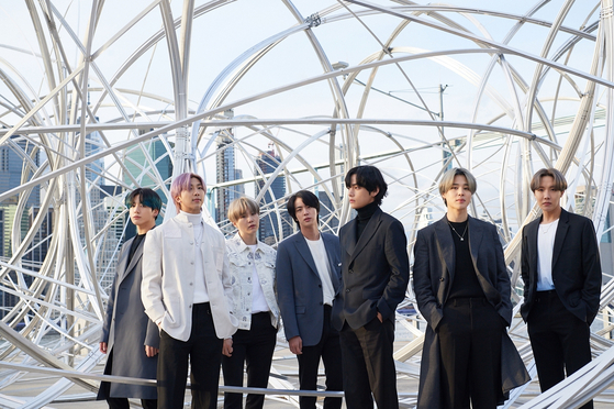BTS stands next to Antony Gormley's installation piece ″New York Clearing″ as a part of its contemporary art project ″CONNECT, BTS″ last year. [BIG HIT ENTERTAINMENT]