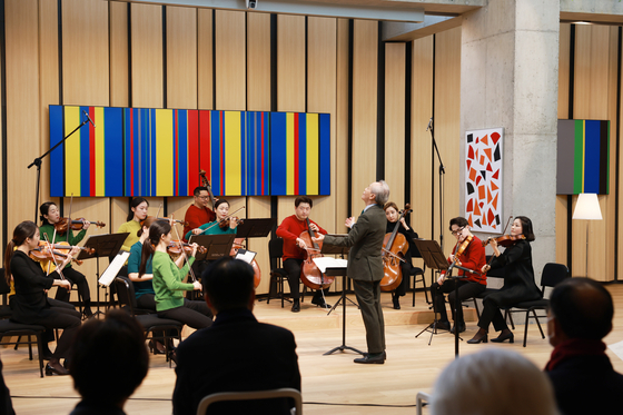 Gum rehearses with musicians at the Concert Hall of the new GMC prior to its official opening on April 3.  [KISWIRE]
