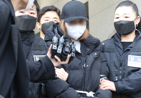 The 3-year-old girl's biological mother, a 48-year-old woman, entering a court in Daegu on March 17 for the hearing on her arrest warrant. [NEWS1]