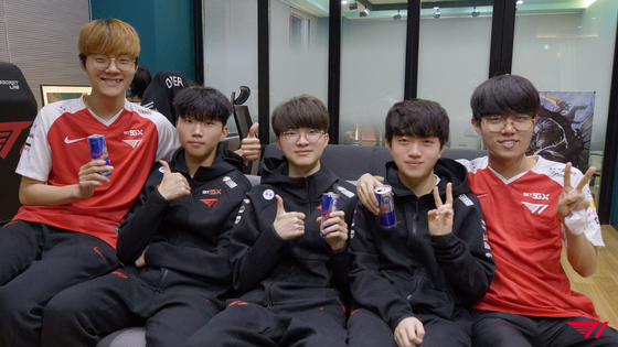 The T1 League of Legends team pose for the camera at their training facility. [T1]