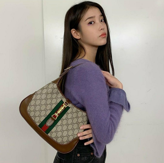 Singer IU is a brand ambassador for luxury brand Gucci. [GUCCI]