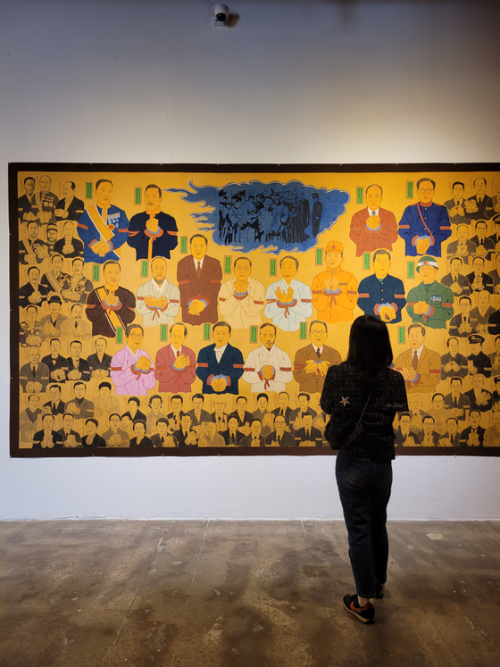 Korean artist Sangho Lee's 2020 painting that depicts 92 historical Korean figures, who the artist thinks supported the Japanese imperialism ruling of Korea (1910-45), tied up to be punished. [MOON SO-YOUNG]
