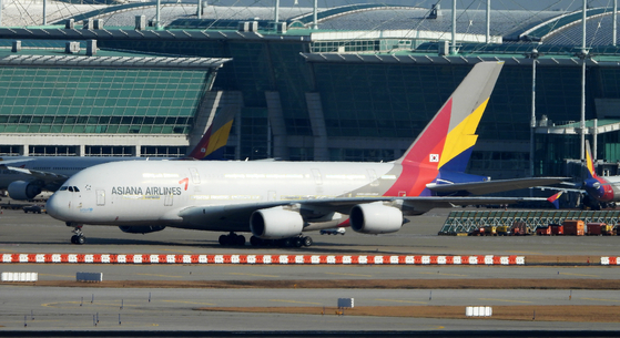An Asiana Airlines aircraft parked at Incheon International Airport in November. [NEWS1]