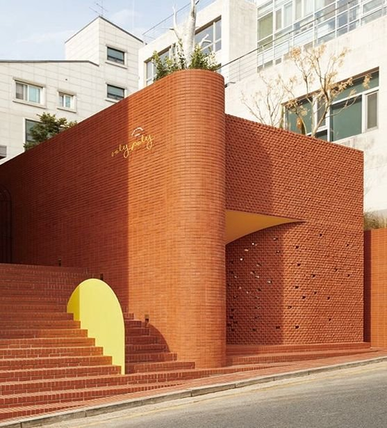 Ottogi's Roly-poly Cotto, located at Gangnam, southern Seoul. The Roly-poly Cotto is built with 100,000 orange bricks, standing out amongst the residential neighborhood. [OTTOGI]