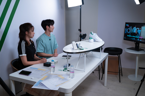 Show hosts look at a monitor during a live commerce show at Kakao Commerce Studio in Pangyo, Gyeonggi. [KAKO COMMERCE]