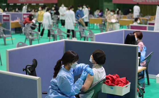 People get AstraZeneca shots at a vaccination center in Gwangju, as the rollout of the temporarily-suspended AstraZeneca vaccines resumed Monday. [YONHAP]