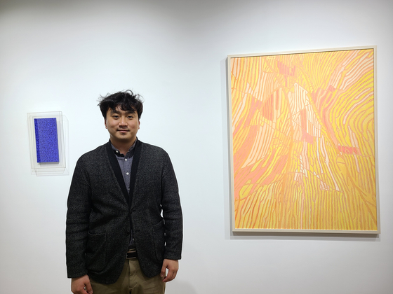 Bryan Bhak poses for a photo at his gallery BHAK in Hannam-dong, central Seoul. [LEE SO-AH]