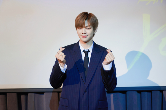 "Singer Kang Daniel poses during a press conference for his upcoming EP ""Yellow"" on Tuesday at CGV Cheongdam Cinecity in Gangnam District, southern Seoul. ""Yellow,"" the third and final part of his ""color trilogy"" series, was released on Tuesday at 6 p.m. [KONNECT ENTERTAINMENT]"