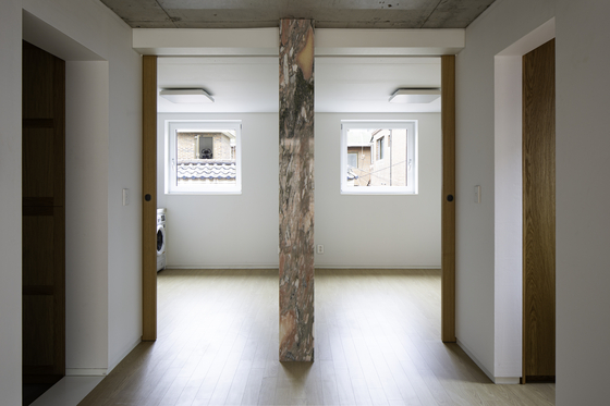 Inside a two-roomed apartment in Cascade House. The kitchen is on the left, and the bedroom on the right. [JIN HYO-SOOK]