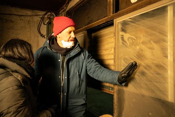 """Nikita Golubev, the dust artist who drew several artworks that appear in the film """"Dust-Man,"""" on the set of the film in 2018. [THURSDAY MORNING]"""