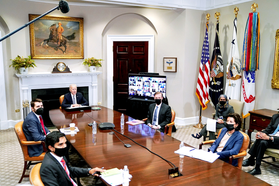 U.S. President Joe Biden speaks during the virtual CEO summit on semiconductor and supply chain at the White House on Monday. [EPA/YONHAP]