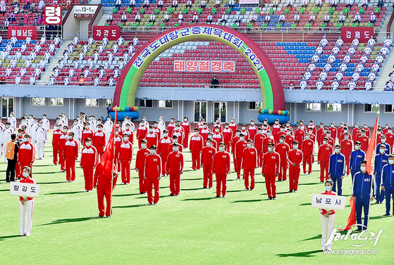 North Korea holds a sports event with participants all masked on April 6, a week ahead of the Day of the Sun, or founder Kim Il Sung's birthday anniversary, which falls on Thursday. [YONHAP]