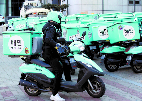 Food delivery motorcycles of Baedal Minjok, also known as Baemin, are parked in the company's rider center in southern Seoul. [NEWS1]