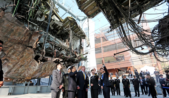 U.S. and South Korean military officials visit the wreck of the Cheonan in 2015. [JOINT PRESS POOL]