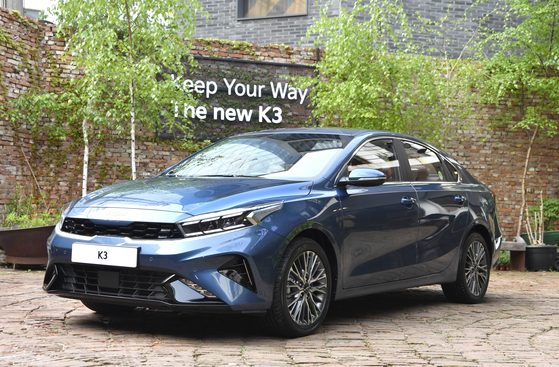Kia's The new K3 is on display at a cafe in Seongdong District, eastern Seoul on Tuesday. The new model is an upgraded version of the automaker's K3 sedan, which was released in 2018. [KIA]