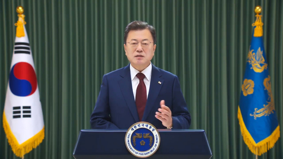 President Moon Jae-in speaks in a video message to the Boao Forum for Asia hosted by China Tuesday. [JOINT PRESS CORPS]