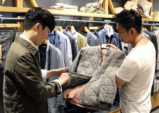 A male customer shops at a fashion store at Shinsegae Department Store. [SHINSEGAE DEPARTMENT STORE]