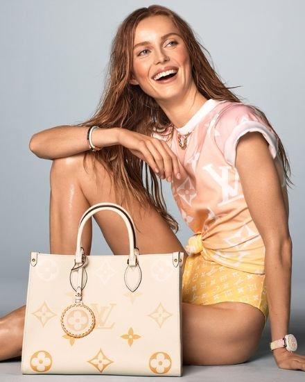 A model poses with a Louis Vuitton bag. Louis Vuitton's net profit in 2020 surged to 70.3 billion won ($62 million), up 285 percent. [LOUIS VUITTON]