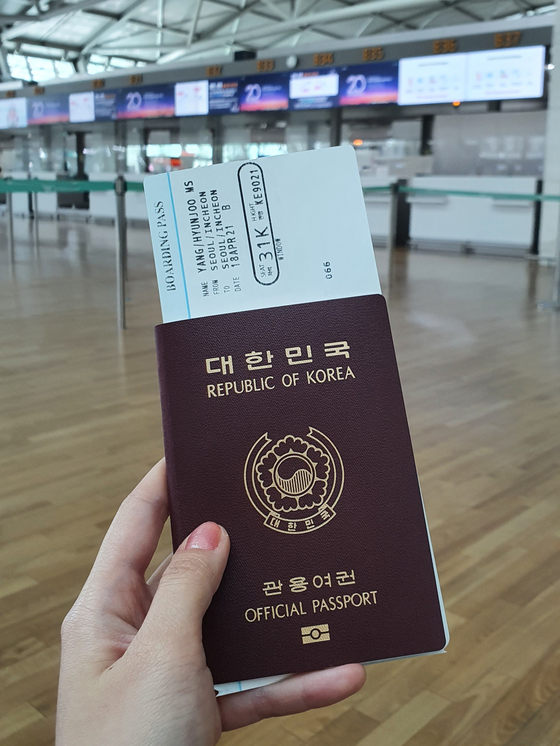 The boarding pass reads: From Seoul/Incheon to Seoul/Incheon. [HALEY YANG]