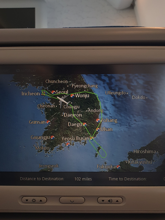 "The final travel route of the ""flight to nowhere"" shown on the in-flight movie screen. [HALEY YANG]"