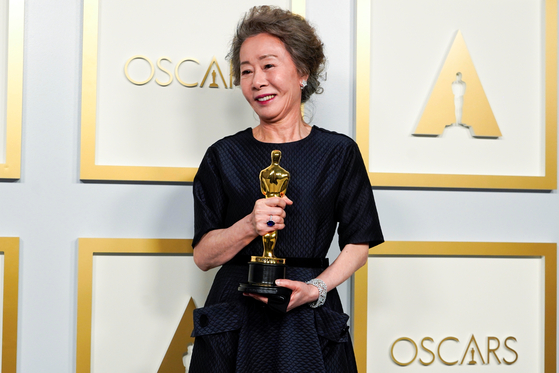 Youn Yuh-jung, winner of the award for Best Actress in a Supporting Role for ″Minari,″ poses in the press room at the Oscars in Los Angeles. [REUTERS/YONHAP]
