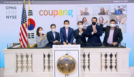 Coupang founder and CEO Kim Bom-suk, third from left, upon the e-commerce company's listing on the New York Stock Exchange in March. Coupang was designated a large business group by the Fair Trade Commission on Thursday. [YONHAP]