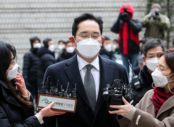 Samsung Electronics Vice Chairman Lee Jae-yong interviewed by reporters ahead of the verdict being read at the Seoul High Court in Seocho-dong, southern Seoul, on Jan. 18. He has since been serving a jail term for bribery.