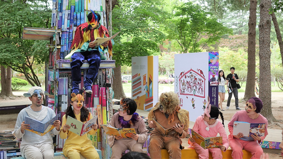 People in costumes gather together to read books at the 2019 edition of the Nami International Children's Book Festival. [NAMI ISLAND]