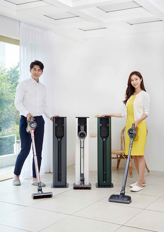 Models pose with LG Electronics's new ″All-in-One Tower,″ a holder with built-in charging and dustbin-emptying functions for the LG CordZero A9 and A9S ThinQ vacuum cleaners. [YONHAP]